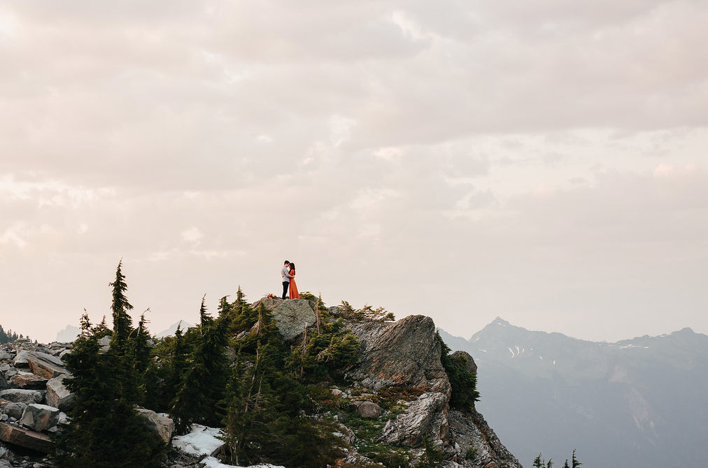 An Engaged Couple Embracing Each Other on Mt. Baker, Whatcom County