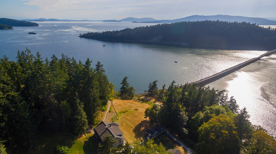Aerial shot of a residential home by Bellingham Bay, Whatcom County