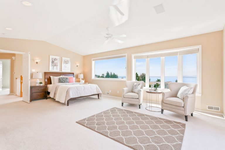 Ocean view residential room of a real estate with a bed